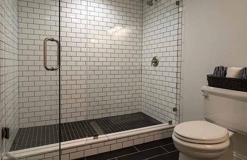 shower enclosure with white subway tile