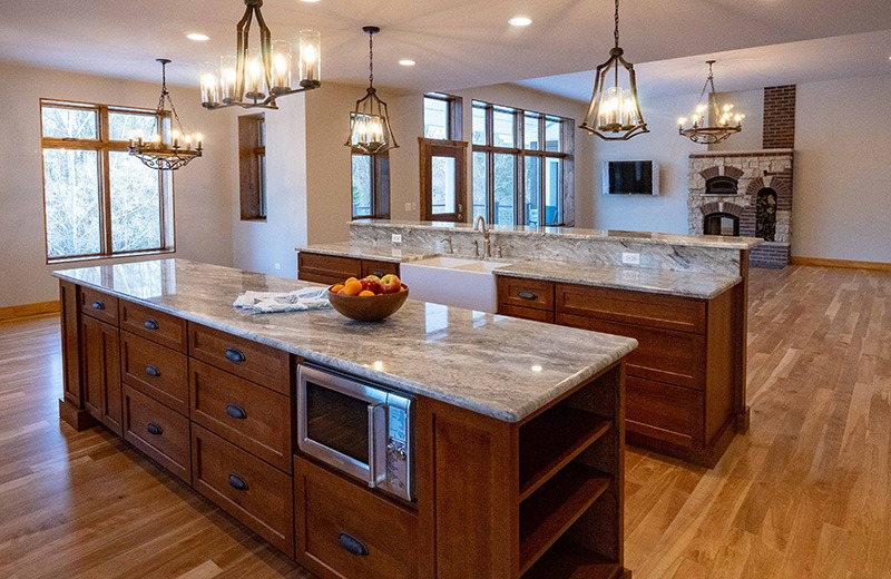 Two large kitchen islands open into living area