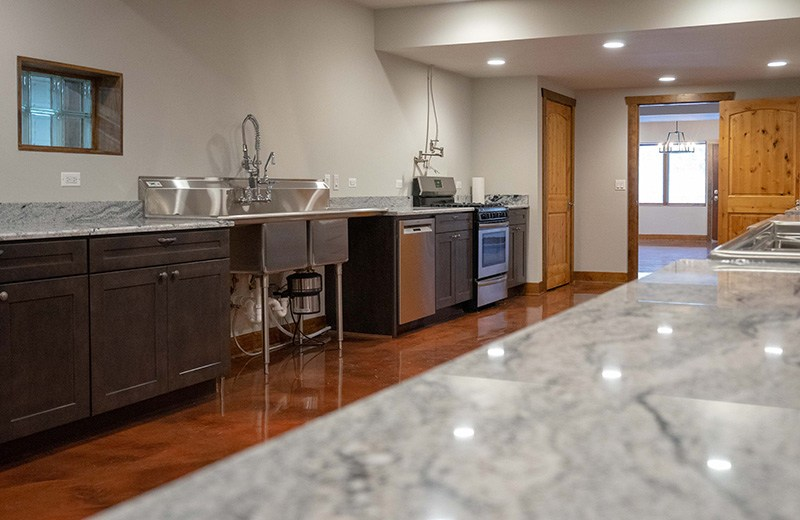 Custom built energy efficient home - canning room with his and her ranges