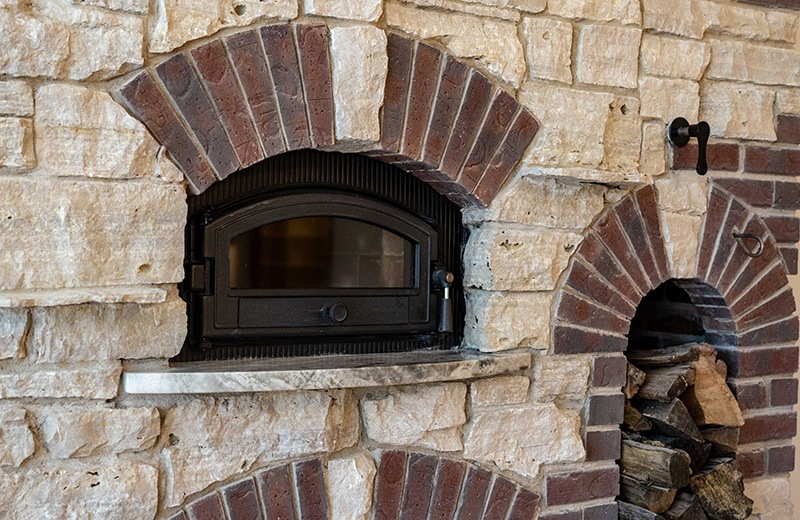 Masonry Heater Doubles as an Oven