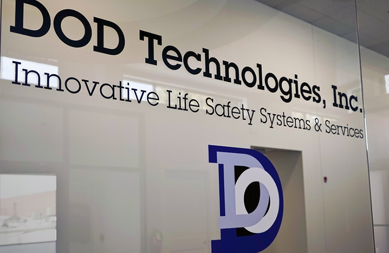 front window of DOD Technologies with logo on it