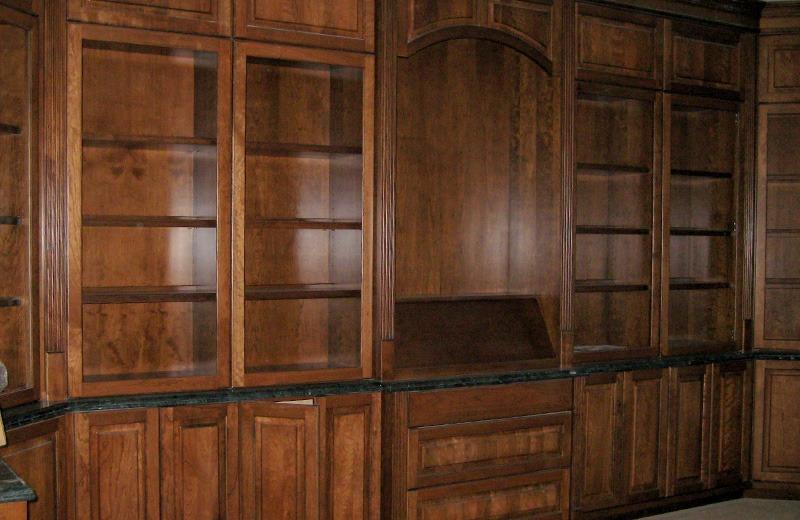 Custom built luxury home - custom wood cabinet library