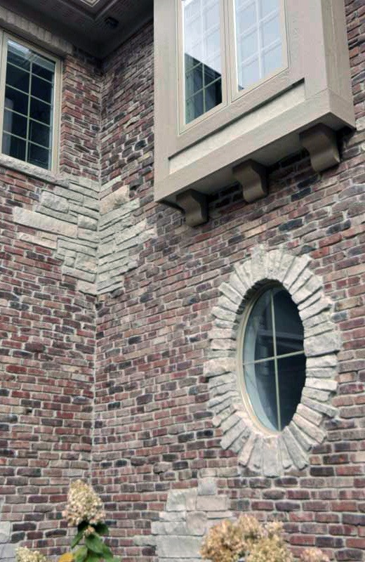 Custom built luxury home - brick and stone detail on front of home