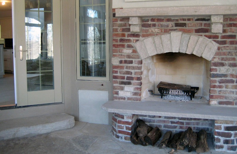 Custom built luxury home -fireplace on the porch next to the whirlpool