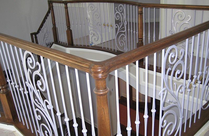 Custom built luxury home - custom wood and metal staircase detail