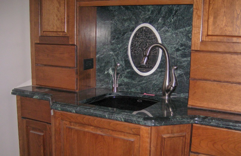 Custom built luxury home - wood cabinets with marble bar