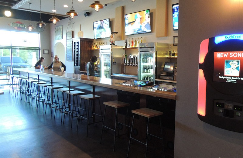 Commercial renovate - expanded the take-out service to include a dine in area with a bar