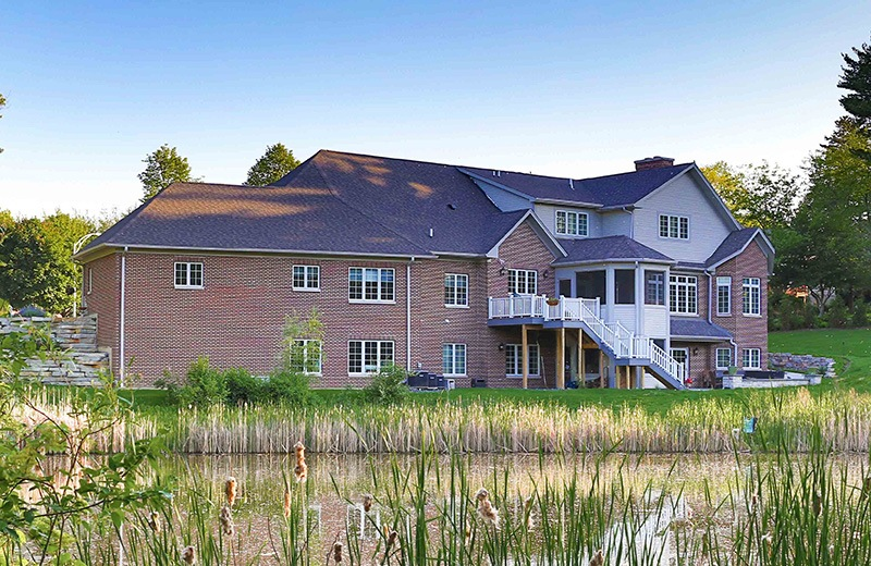 Back of house facing pond