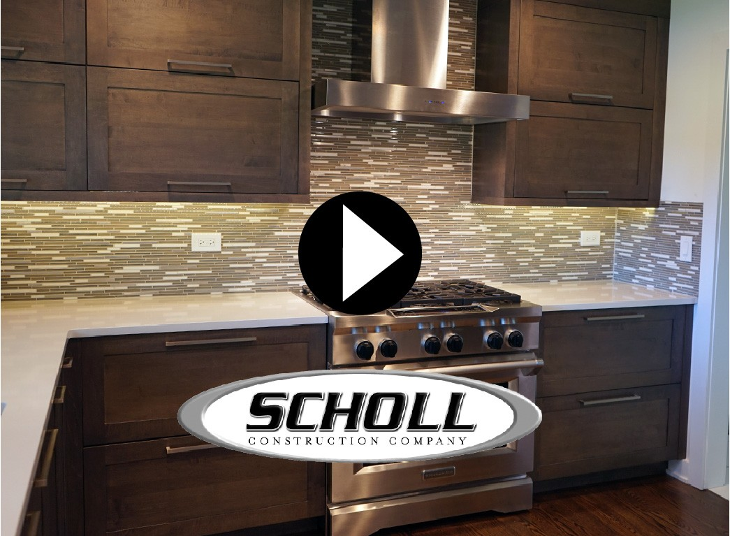 kitchen with dark cabinets and stainless steel stove