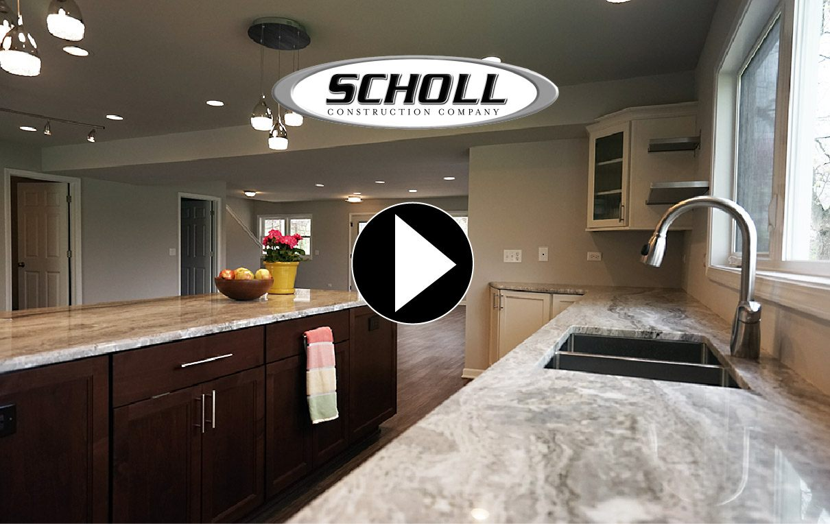 custom kitchen with chocolate-colored shaker cabinets and granite countertops