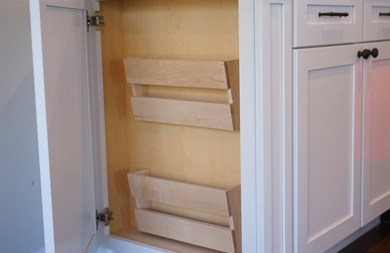 Custom cabinet detail showing book racks
