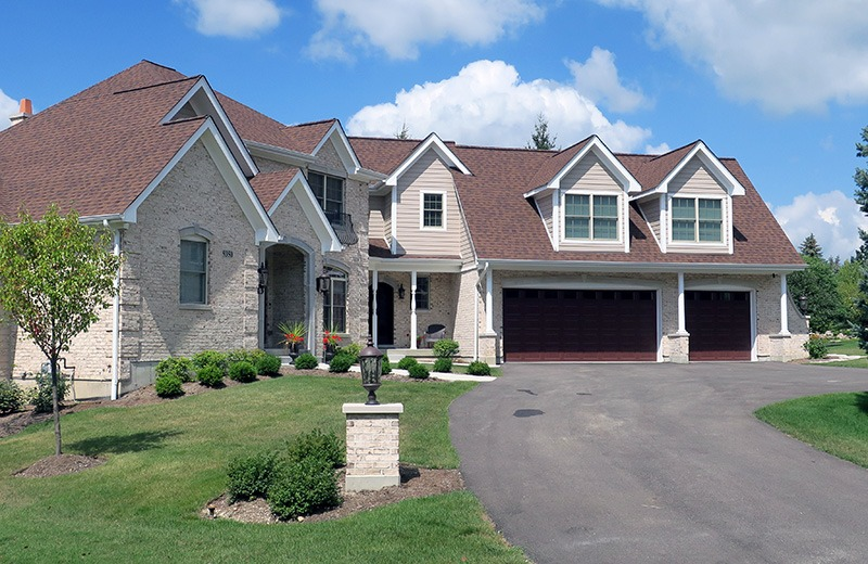 Custom built luxury home - front of house - ivory brick with red roof