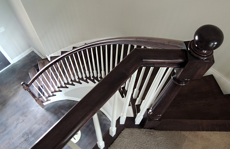 entry with Custom built, maple curved staircase