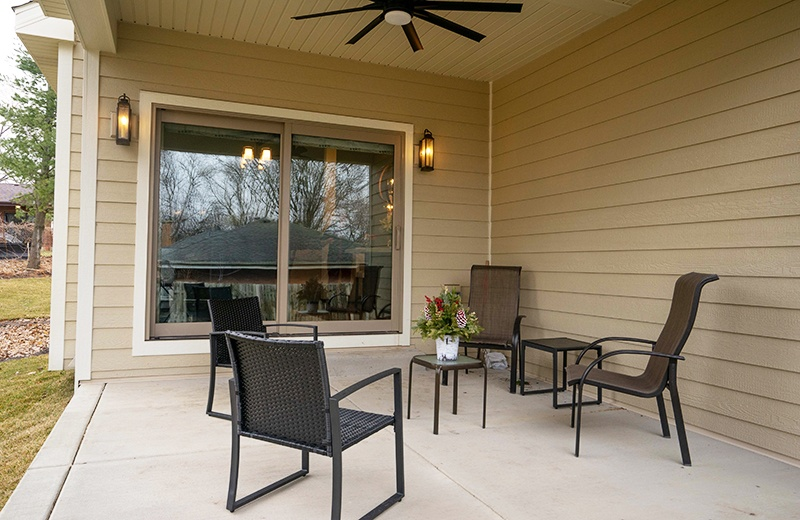 outdoor patio with ceiling fan