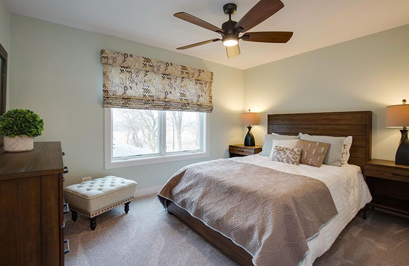 upstairs guest room with ceiling fan