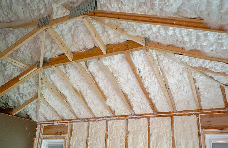 green construction spray foam in ceiling rafters