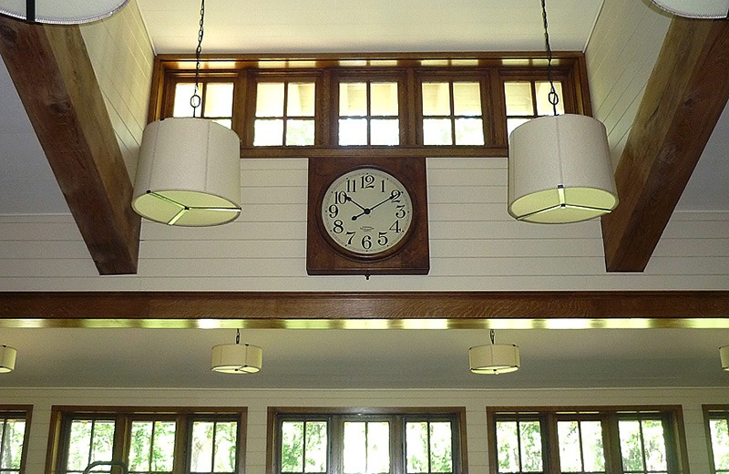 View of upper windows and clock in workout room