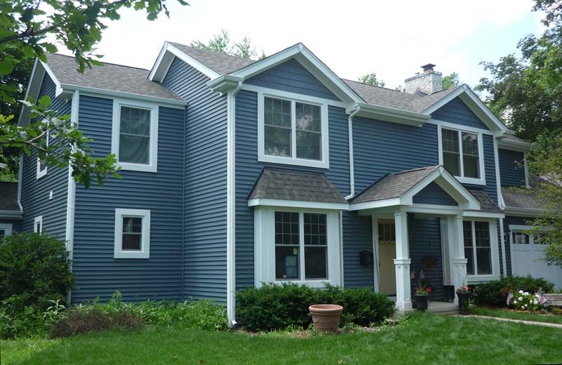 blue house with white trim outside front