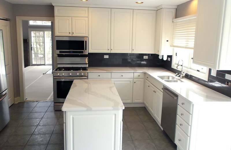black and gray kitchen with island