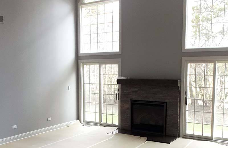 Living room with tall ceilings and fireplace